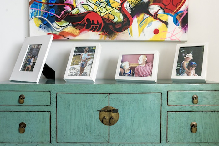 turquoise cupboard and colourful painting